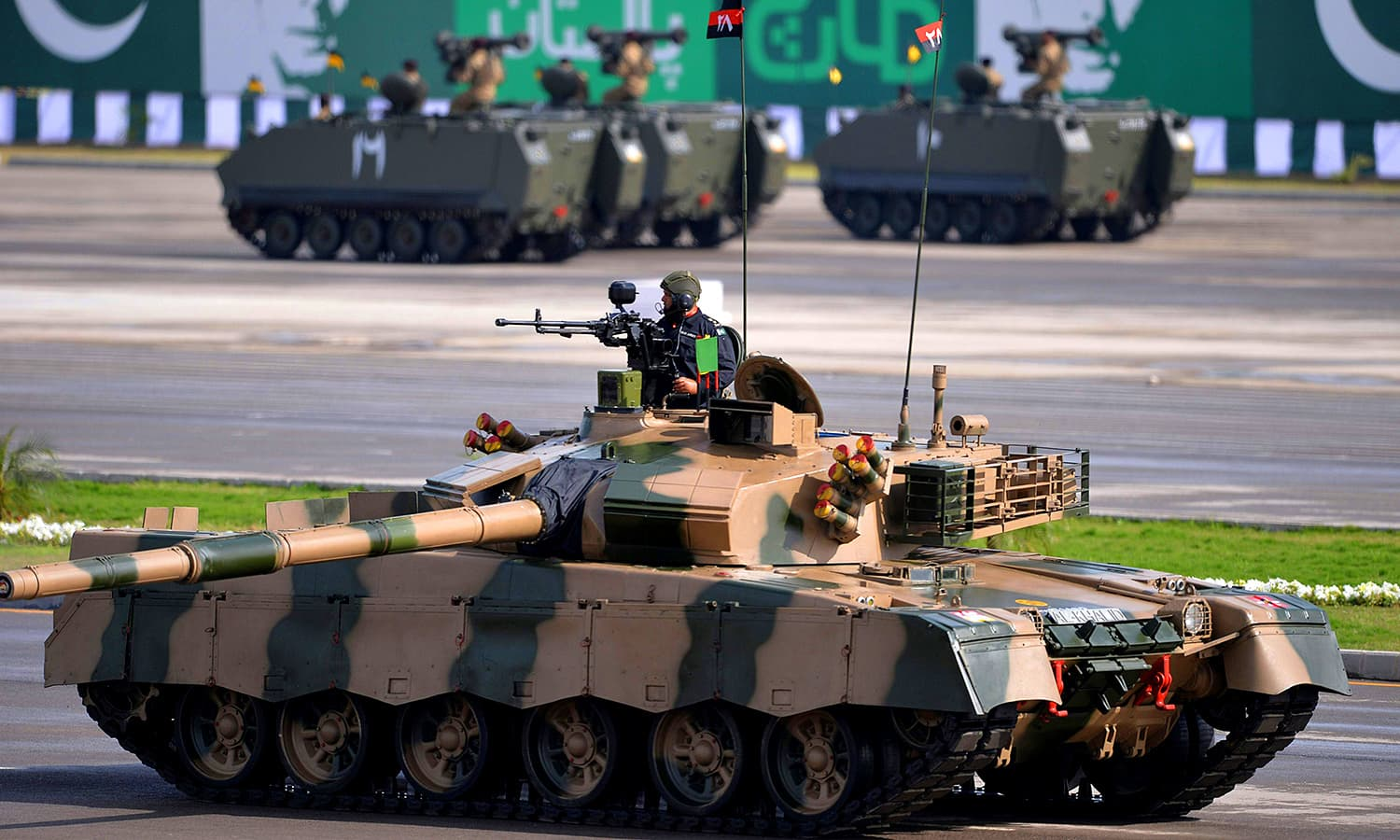An Al-Khalid tank presents a salute to the president. ─ AFP