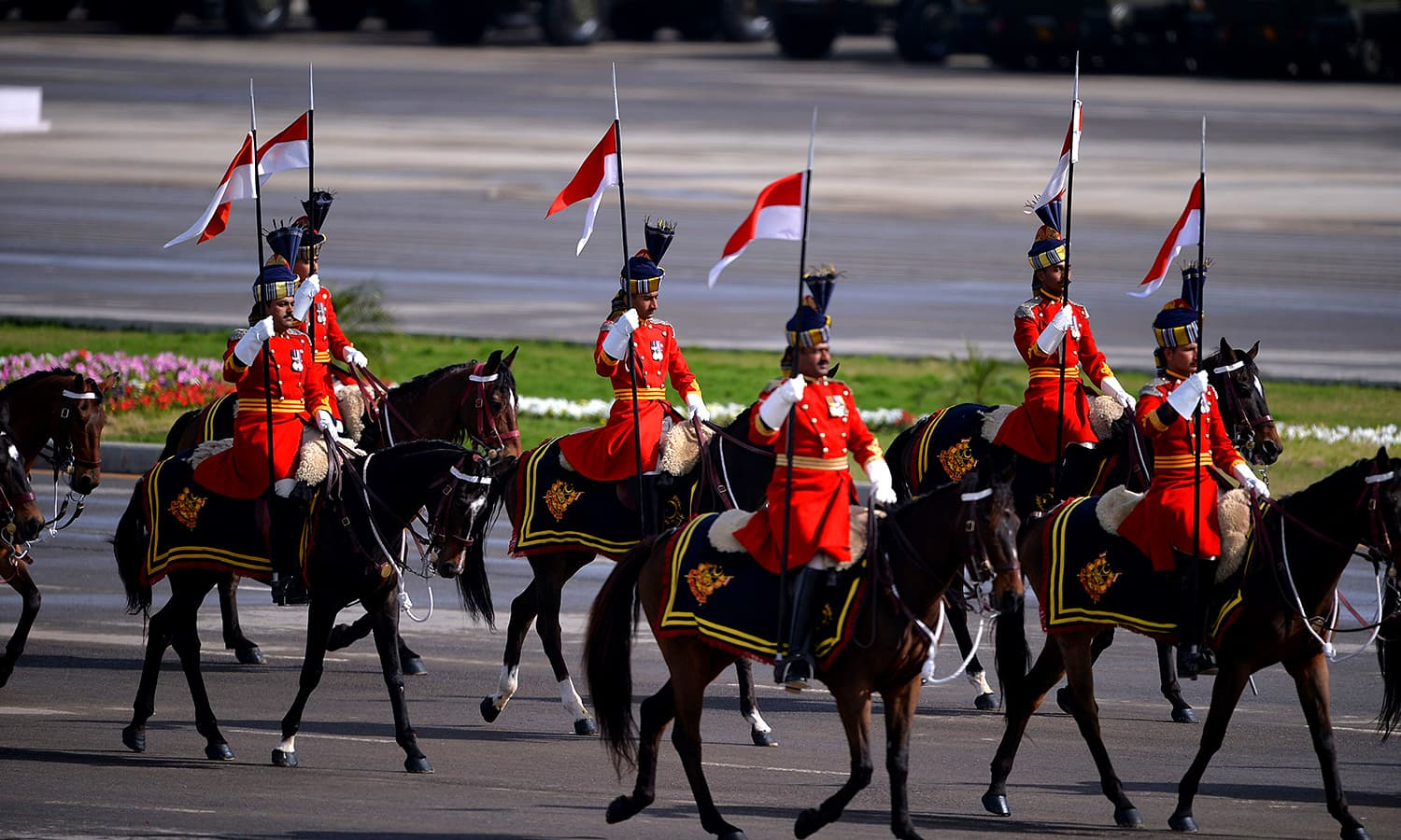 Special presidential guards march past on horseback during the Pakistan Day military parade. ─ AFP
