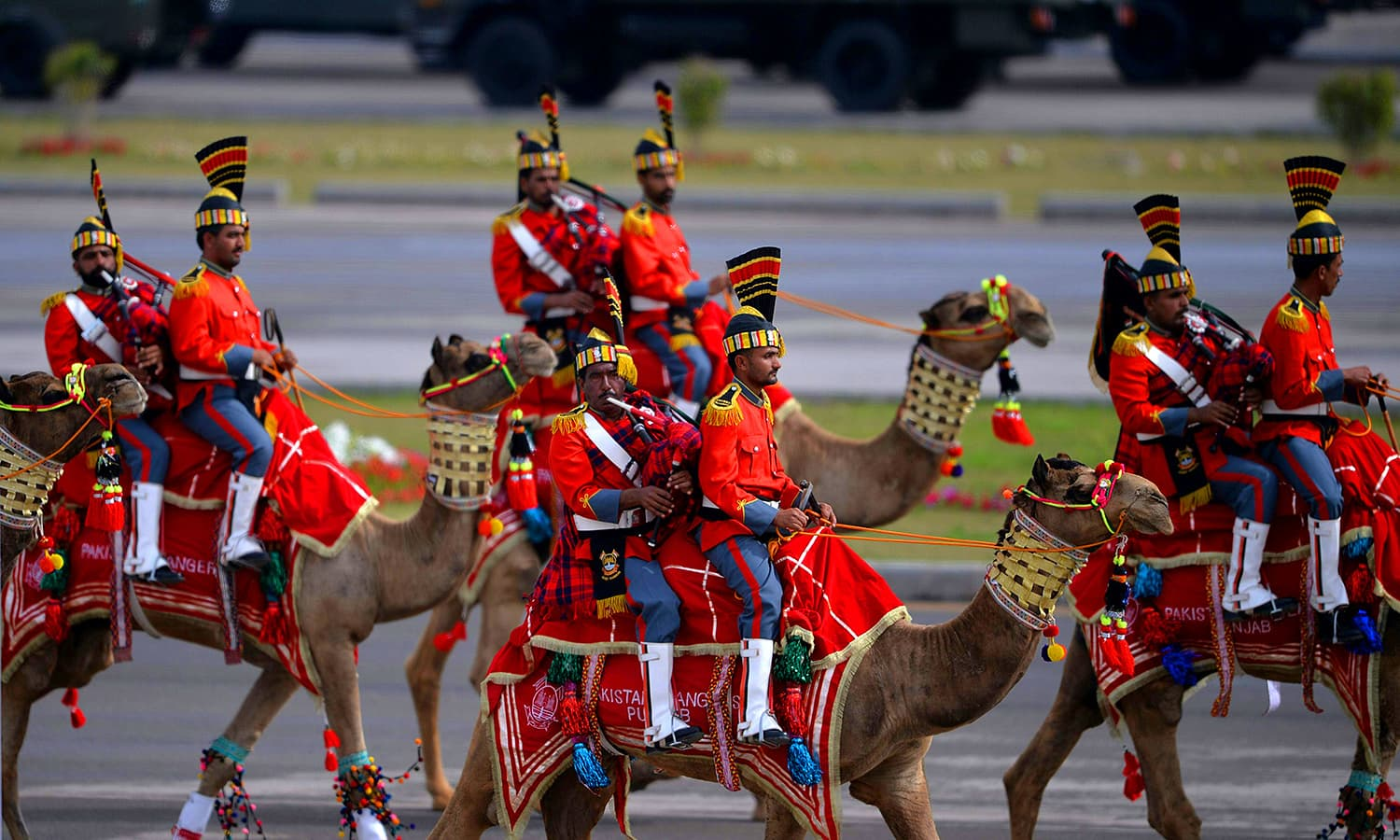 A camel-mounted military band performs during the Pakistan Day military parade. ─ AFP