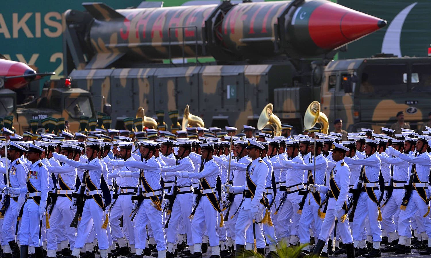 Naval soldiers march past long-range ballistic Shaheen III missiles during the Pakistan Day military parade. — AFP