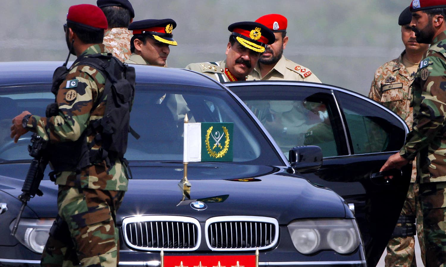 Army Chief General Raheel Sharif leaves after attending the Pakistan Day military parade. ─ AP