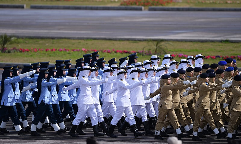 Female armed forces personnel march during the Pakistan Day military parade. ─ AFP