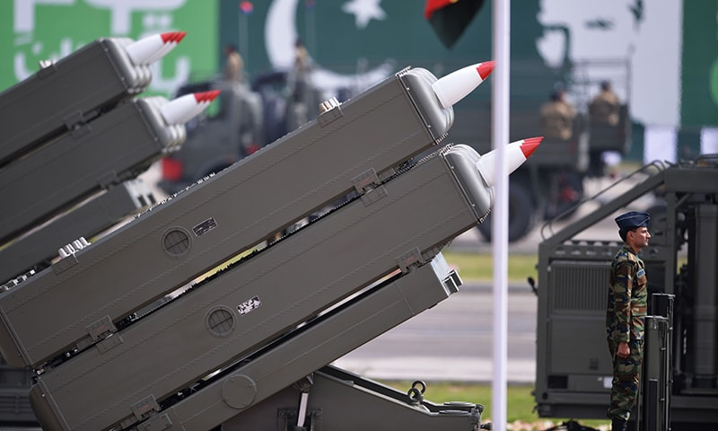 Armed forces personnel take part in the Pakistan Day military parade. -AFP