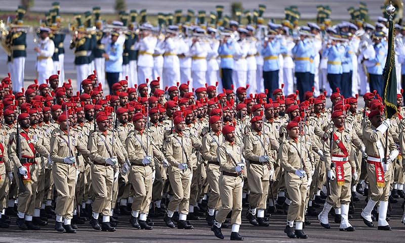 Military personnel march during the Pakistan Day military parade. -AFP