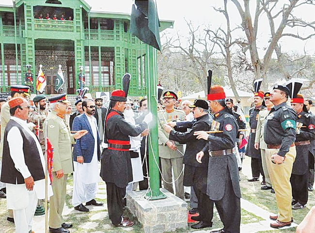 BALOCHISTAN Chief Minister Nawab Sanaullah Khan Zehri hoists the national flag at the Ziarat Residency on Wednesday.—APP