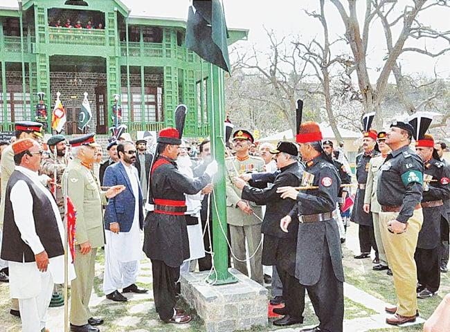 BALOCHISTAN Chief Minister Nawab Sanaullah Khan Zehri hoists the national flag at the Ziarat Residency on Wednesday.—APP