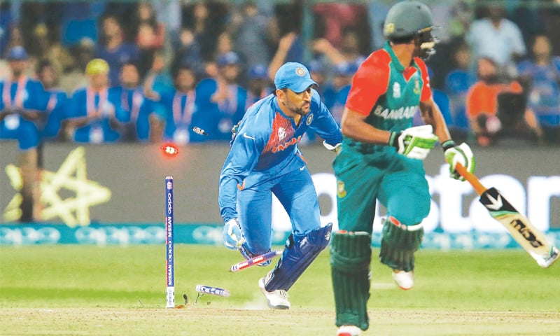 BANGALORE: Indian captain M.S. Dhoni runs out Bangladesh's Mustafizur Rahman to seal victory for India. —Reuters