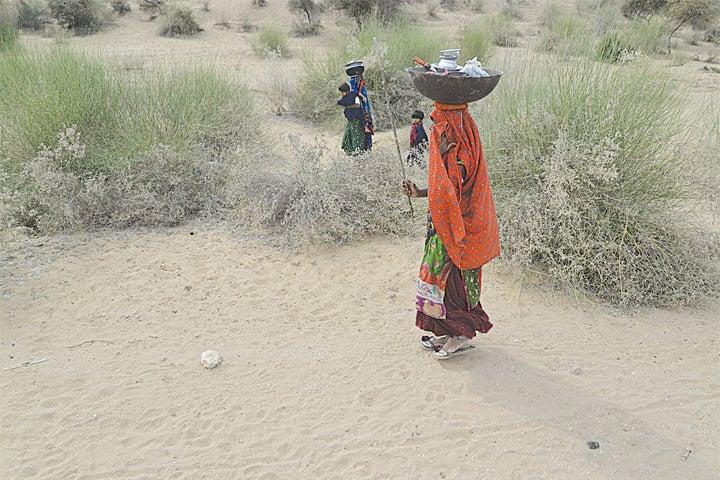 Women walk long distances to fetch water