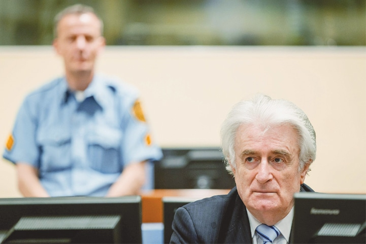 THE HAGUE: Radovan Karadzic sits in the courtroom waiting for pronouncement of the judgment here on Thursday.—AFP