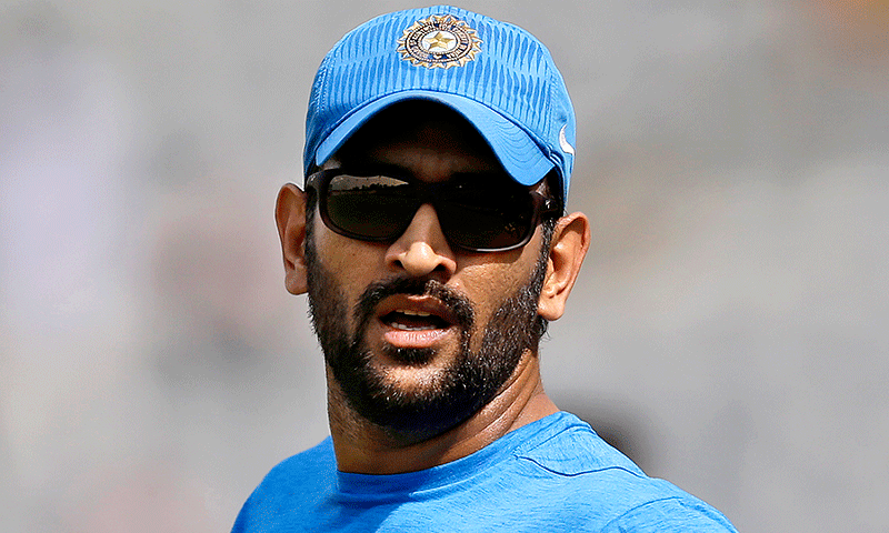 Indian captain MS Dhoni watches his teammates train during a practice session. — AP