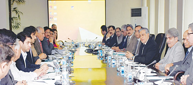 Finance Minister Ishaq Dar presides a meeting of the National Price Monitoring Committee in Islamabad last Thursday. Dar directed relevant authorities to investigate the rise in prices of poultry products, gram pulse, powdered milk etc.