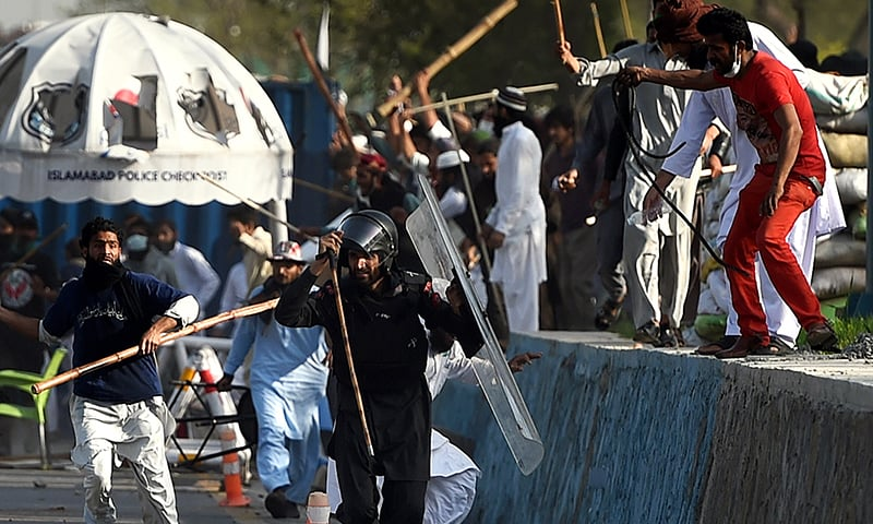 Protesters beat a paramilitary soldier during clashes near the parliament building in Islamabad, Sunday, March 27, 2016.—AP