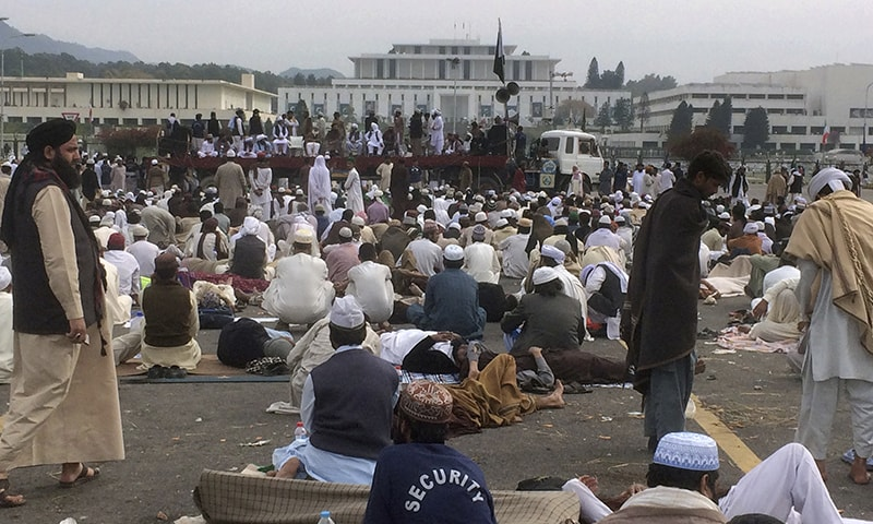 Supporters of the religious parties hold sit-in protest outside the parliament building in Islamabad.─AP