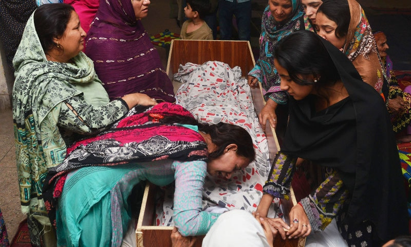 Family members mourn the death of a relative, who was killed in a blast outside a public park in Lahore on March 28, 2016. —AFP