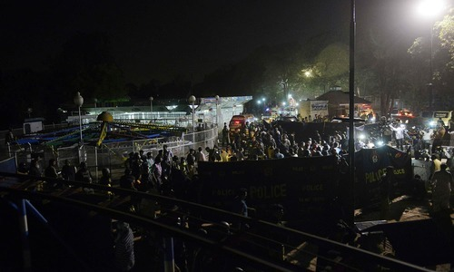Rescuers and officials gather at the bomb blast site in Lahore.─AFP