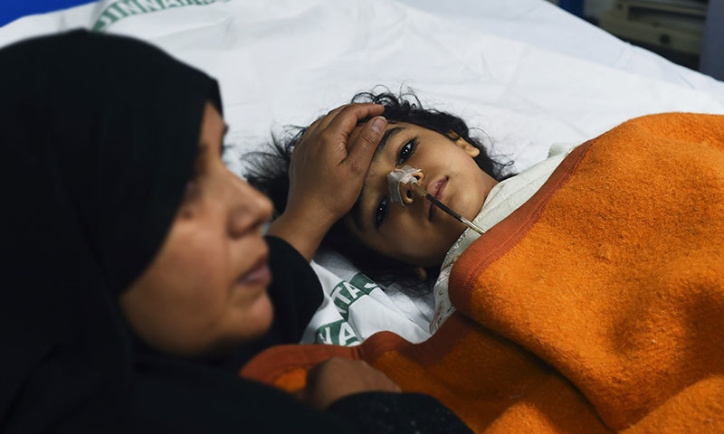 An injured child victim of the suicide blast in Lahore rests in a hospital. — AFP