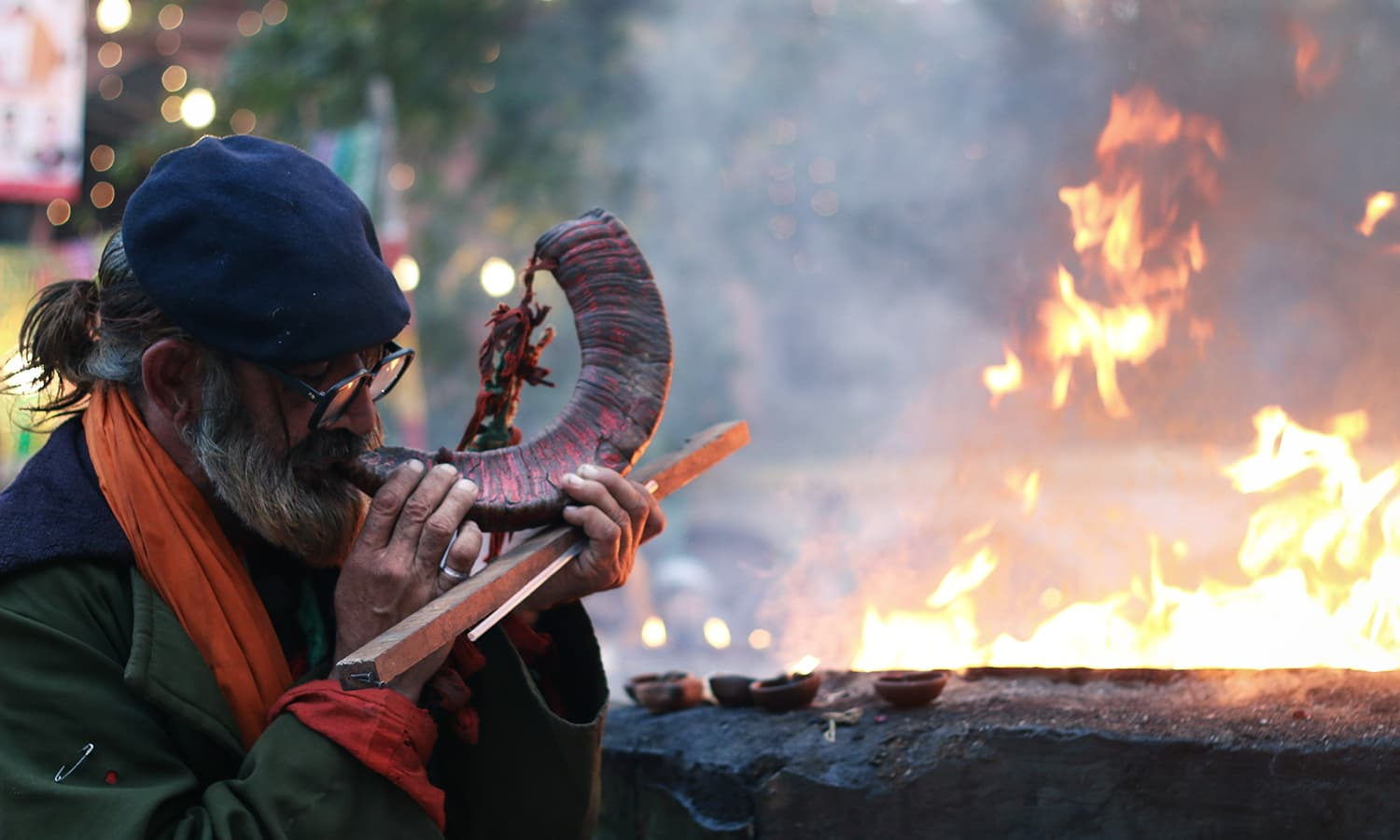 A man blows a herald at the shrine of Hazrat Madhu Lal Hassan.