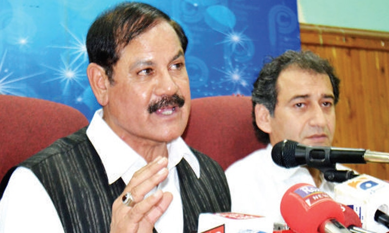 Mushtaq Ghani addressing media persons in Peshawar on Wednesday. — Online