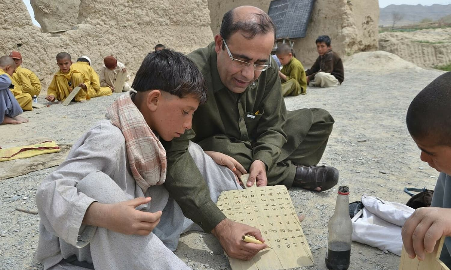 At many of these schools, students can neither write nor speak in Urdu. -Photo by Asmatullah Khan