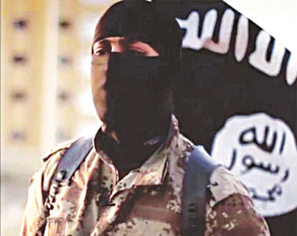 A masked man speaking in a video released by IS militants in 2014. — Reuters