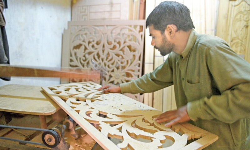 Continuing The Traditional Art Of Hand Carving Wood Pakistan