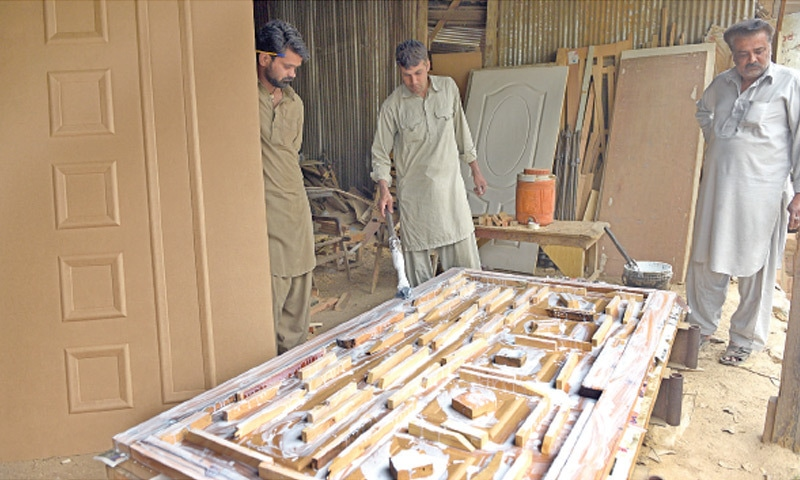 Continuing the traditional art of hand carving wood for Wood doors design in pakistan