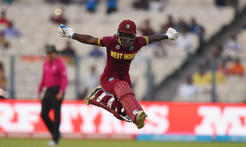 West Indies's Deandra Dottin celebrates after victory in the World T20. — AFP