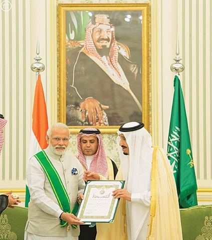 THE photograph provided by the Saudi Press Agency shows King Salman presenting a citation to Narendra Modi after conferring on the Indian prime minister Saudi Arabia's highest civilian award, the King Abdulaziz Sash, on Sunday.—Reuters
