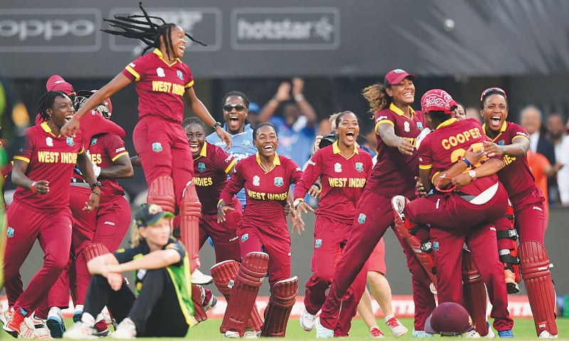 WEST Indies cricketers celebrate after the World T20 women's final against Australia in Kolkata.—AFP