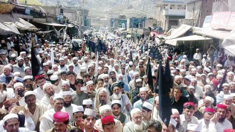 People attend a protest meeting in Landi Kotal on Monday. — Dawn