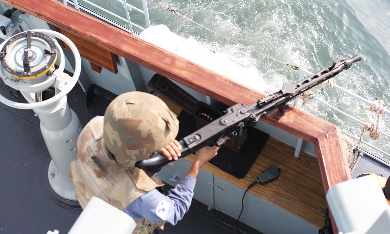 A sailor mans a post on PNS Zulfiquar.