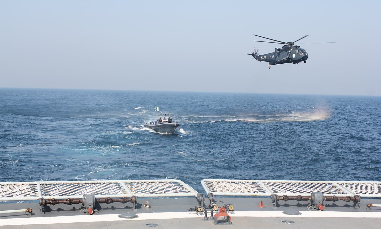 Sea King helicopter and Naval SSG boat make approach towards PNS Zulfiquar.