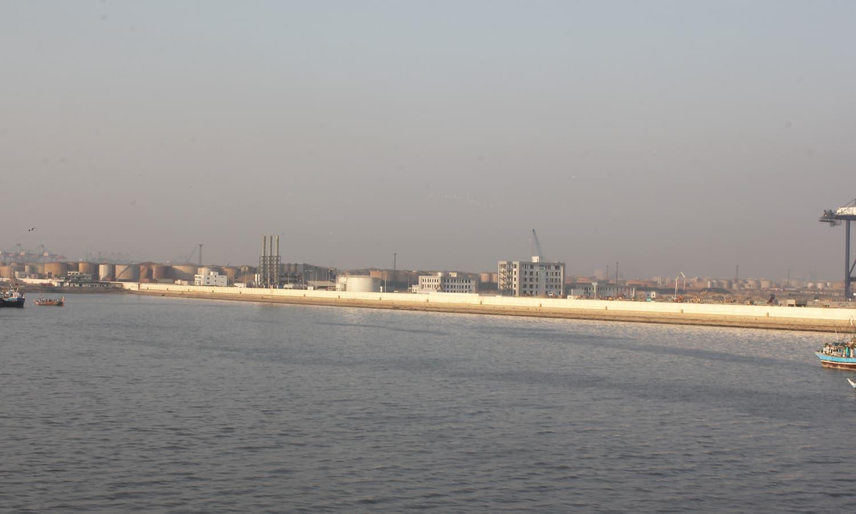 Karachi looks like a smudge of dark smoke on an otherwise clear horizon.