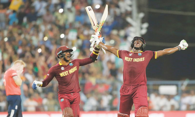 Marlon Samuels and Carlos Brathwaite celebrating after the winning shot