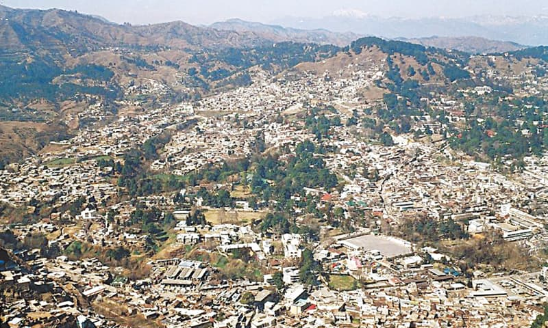 This photo was taken in 2005 from the Sarban mountain overlooking Abbottabad. Much has changed ever since — with the administration allowing construction of buildings in green belts, ravines etc, more concrete structures have emerged and replaced natural cover. Most trees visible here had taken root on government property and the cantonment area; half of them are gone now.