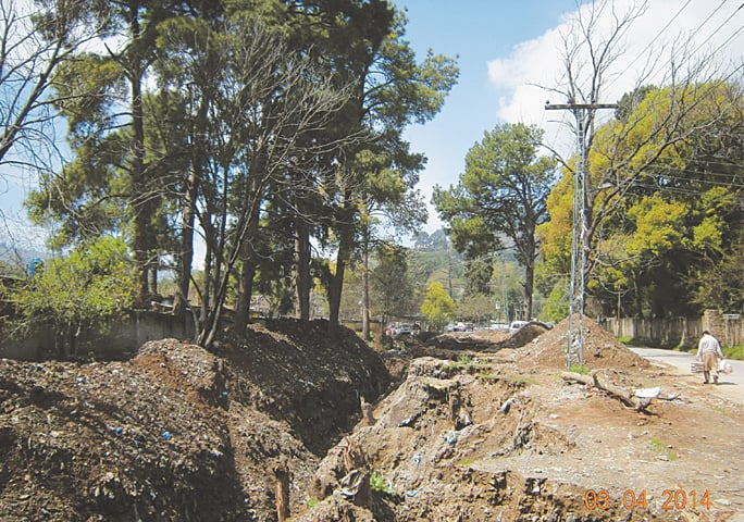 April 3, 2014: Despite stay orders issued by a full bench of the Peshawar High Court, contractors hired by the cantonment board remain busy in uprooting centuries-old trees along the Pine View Road. Bulldozers in the ravine are digging the area to make way for a pukka (concrete) nullah. On April 1, 2014, a contempt of court notice was issued to the CEO of the Cantt Board Abbottabad in this regard.