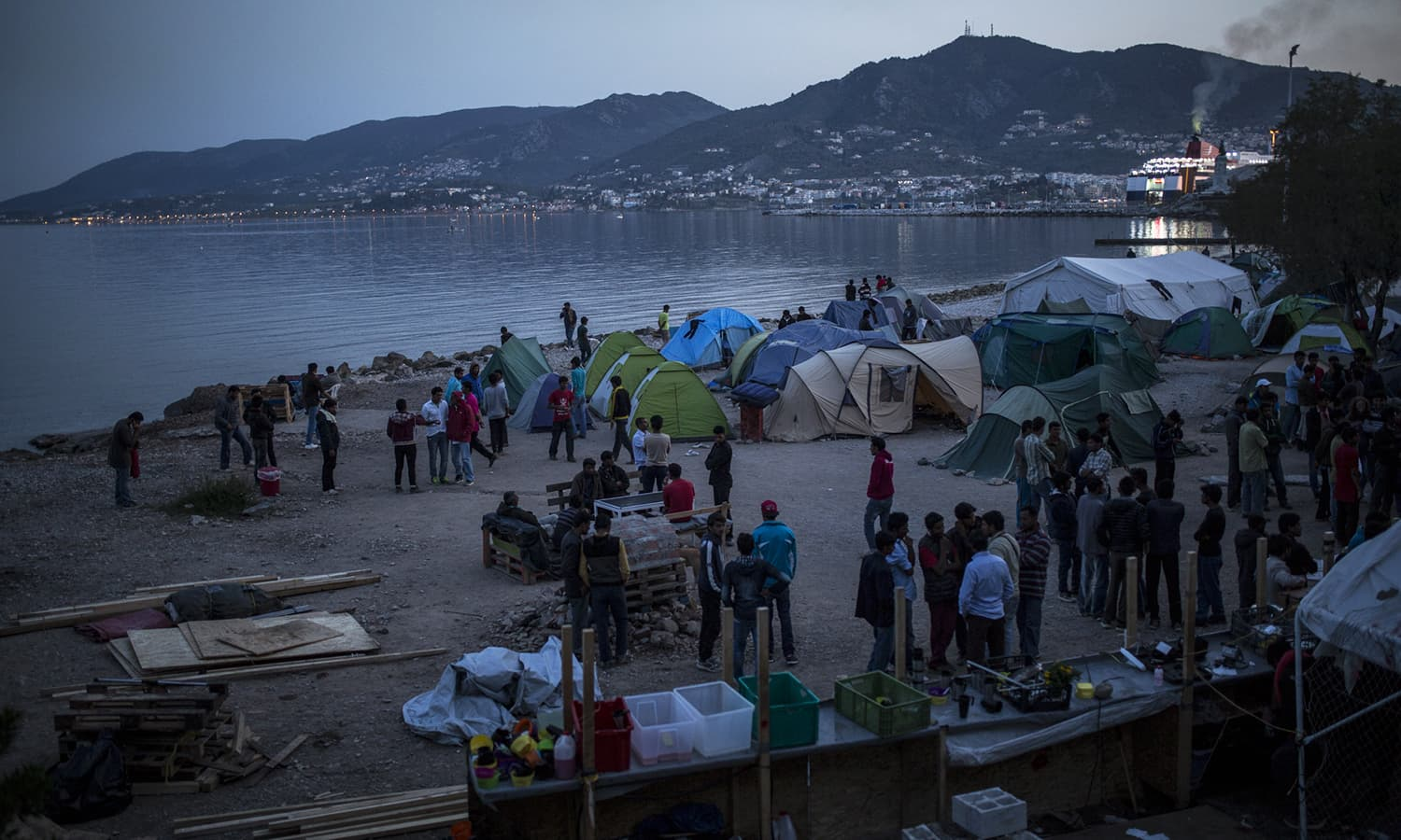 Between 300 and 400 people, mostly Pakistani, are camping on the beach on the Greek island of Lesbos at the No Borders Kitchen.