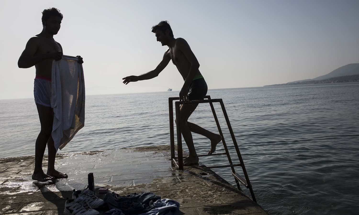 Young Pakistani men after taking a bath in the sea on the island of Lesbos, where hundreds of Pakistanis have been stranded since the Balkan route was closed down at the Greek Macedonian border, at which time Greek authorities decided to prevent migrants from traveling to the mainland, which is already overflowing with migrants.