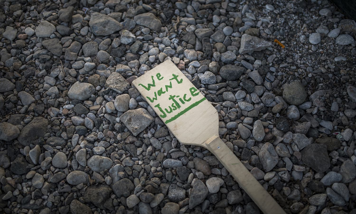 A protest sign at the No Borders camp on the island of Lesbos on April 7, 2016. Although already warned they would be transferred to a detention center on the island, they've been granted a reprieve by the local mayor for an additional week.