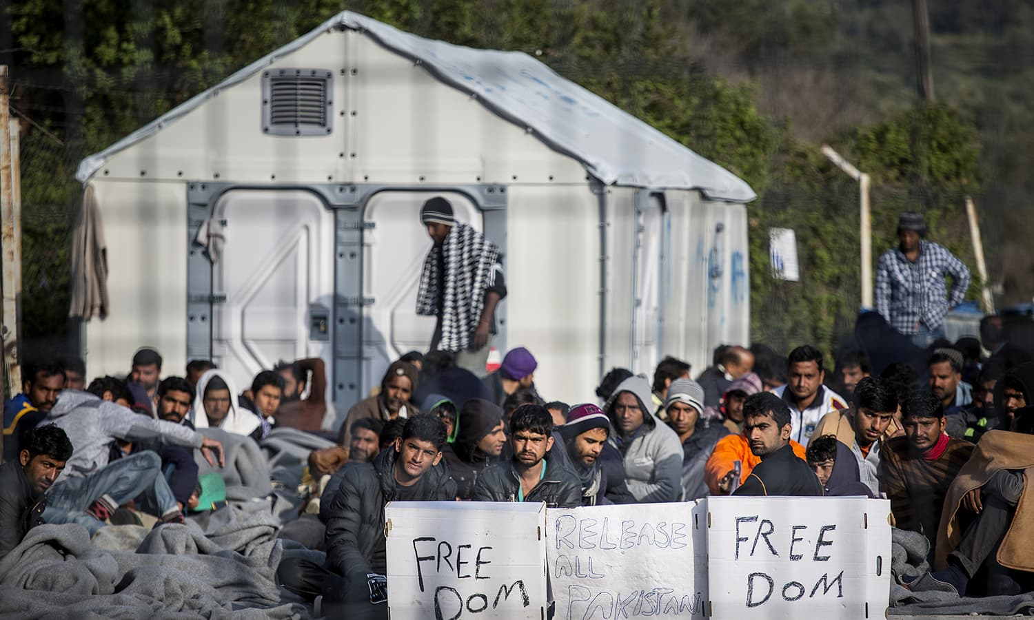 Pakistan migrants hold a hunger strike sit in protest at Moria Camp, a detention center on the Greek island of Lesbos on April 7, 2016. Hundreds of Pakistanis are trapped on the Greek island of Lesbos. Greece began deported immigrants to Turkey last week, among them more than 200 Pakistanis, vastly more than any other group.