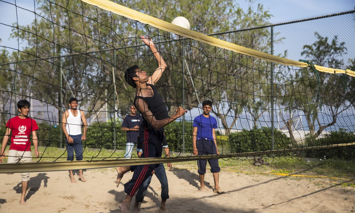 At the No Border Kitchen, an unauthorised camp on the beach on Lesbos island, migrants found a way into the locked volleyball court and have been holding daily matches. Although daily life is pleasant now that the weather is good, many people are very stressed and nervous about the prospect of being forcibly deported back to Turkey and perhaps after that back to Pakistan.