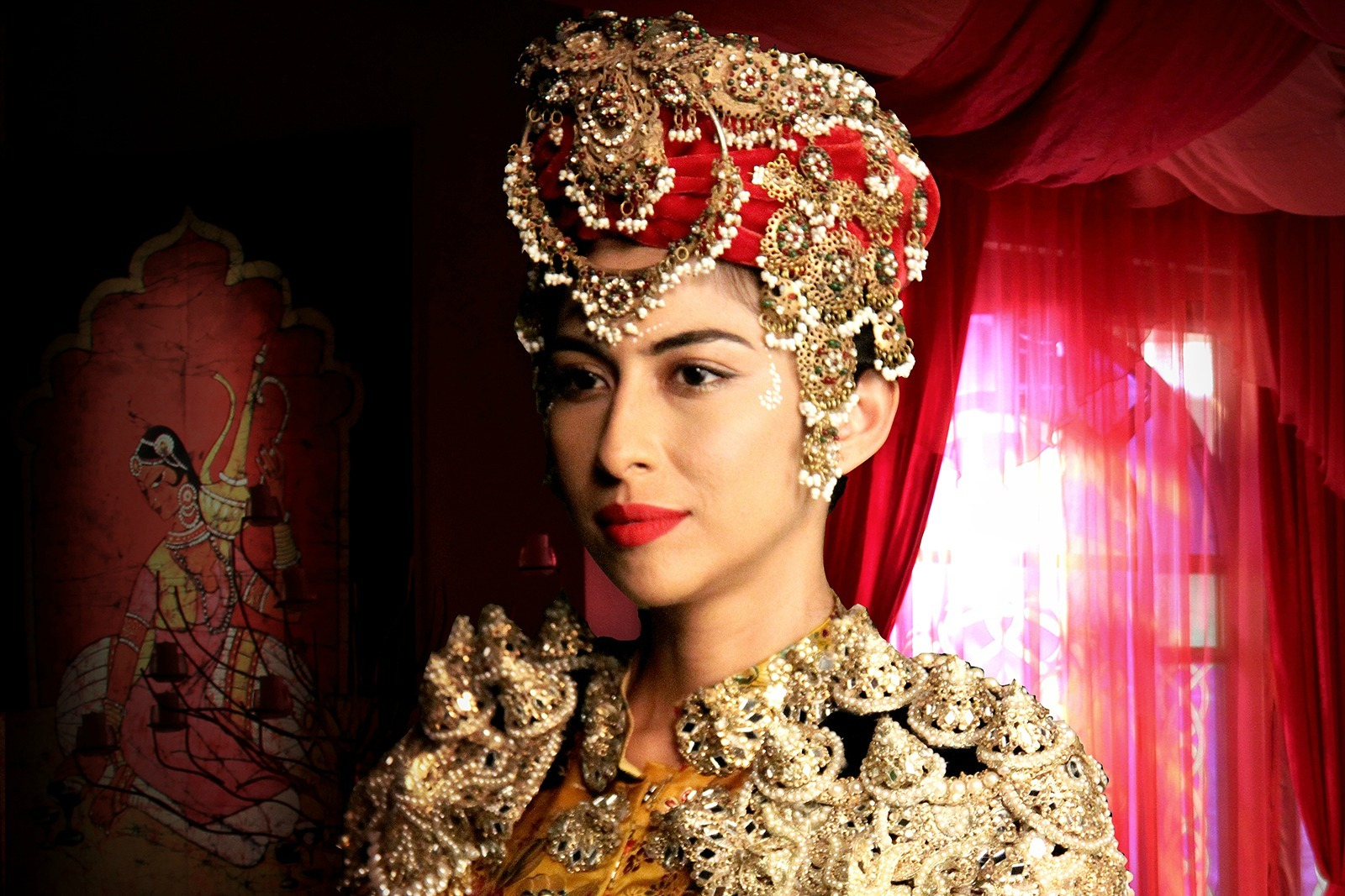 Meesha Shafi's headgear was encrusted with jewellery for a festive in Mor Mahal