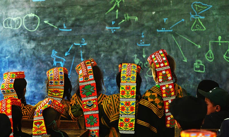 Kalash students attend a class at a school in the Brun village of Bumboret valley. — AFP
