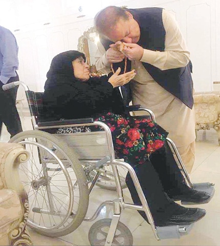 LAHORE: Prime Minister Nawaz Sharif with his mother before leaving for London on Wednesday.—INP