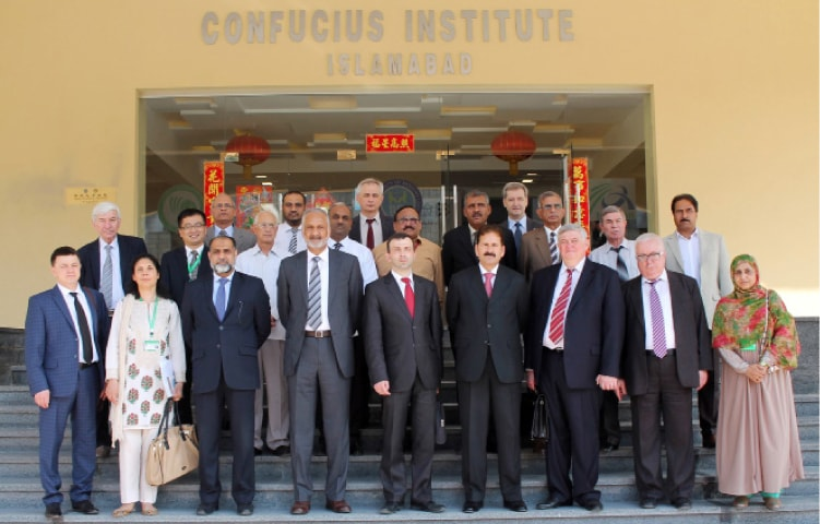 Numl Rector retired Major General Ziauddin Najam and first deputy of the ministry of education of Belarus, Vadim Bogush pose with rectors, VCs of Belarussian universities. — Dawn