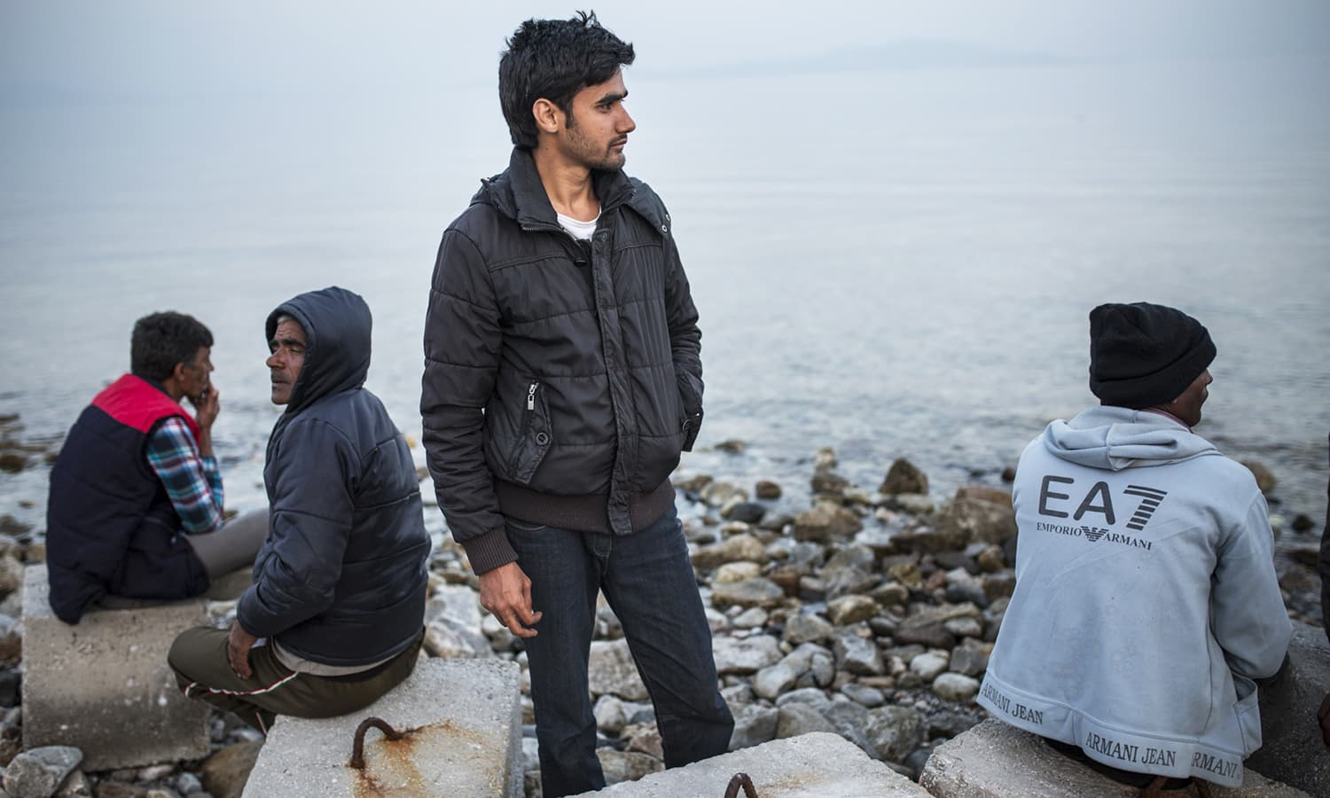 "Nineteen-year-old Omar who was in his second semester of studying electrical engineering at Gujrat University when he decided to leave Pakistan three months ago. After a long journey, he arrived in Greece, but he was too late. The Balkan route had already closed and he, like more than 50,000 other migrants, is now stranded. Although he has brothers working on another Greek island, Greek authorities are not permitting migrants to board ferries or planes to reach other parts of Greece. He said that, ""a lot of people cry here for many reasons."""