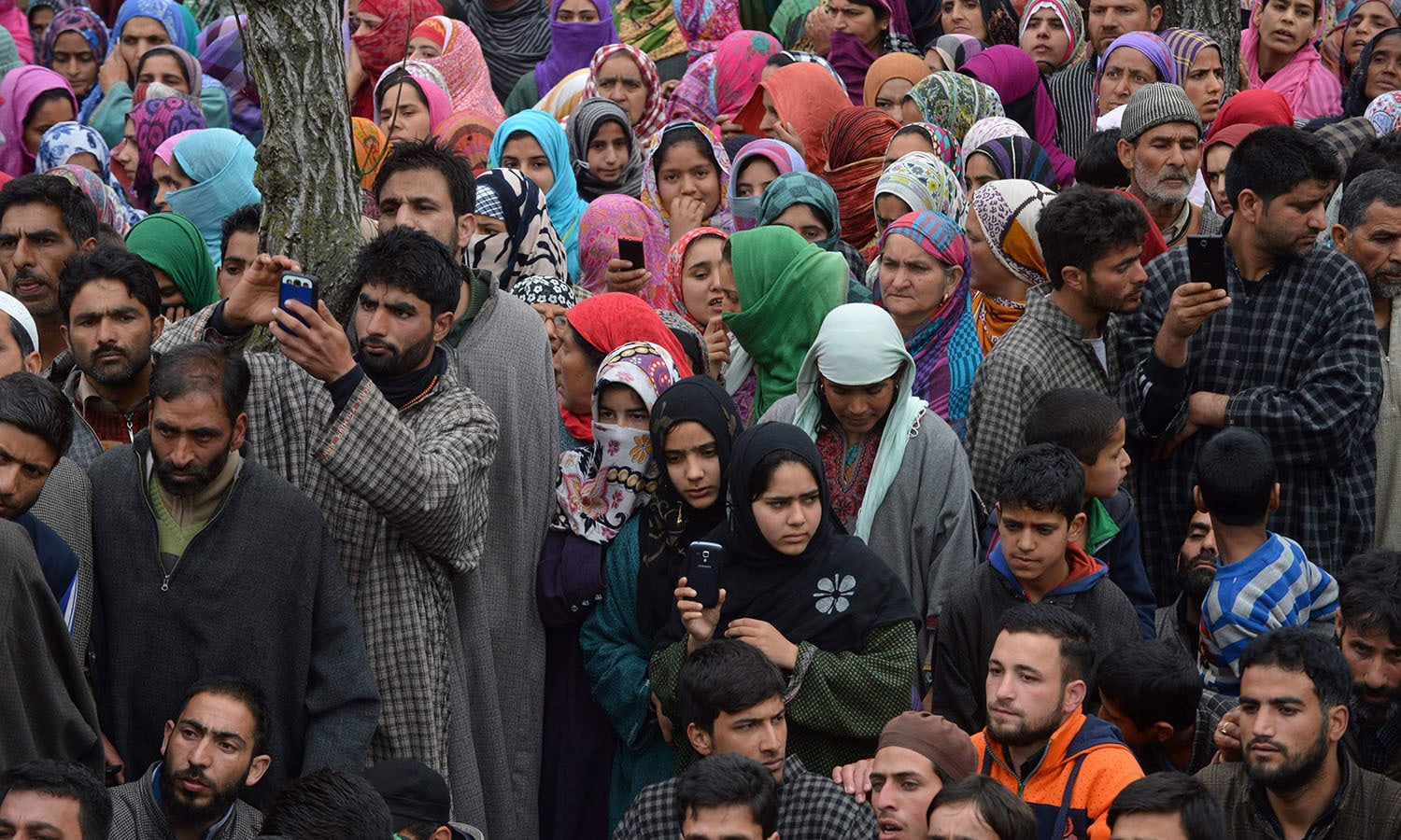 Kashmiri villagers gather during the funeral of freedom fighter Bilal Ahmed Bhat in the village of Karimabad in Pulwama district