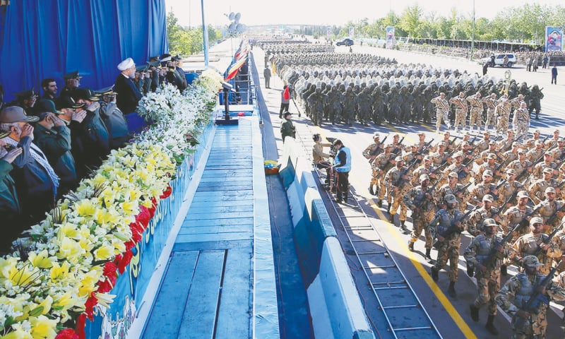 TEHRAN: Iranian President Hassan Rouhani on Sunday attends a military parade marking National Army Day.—Reuters