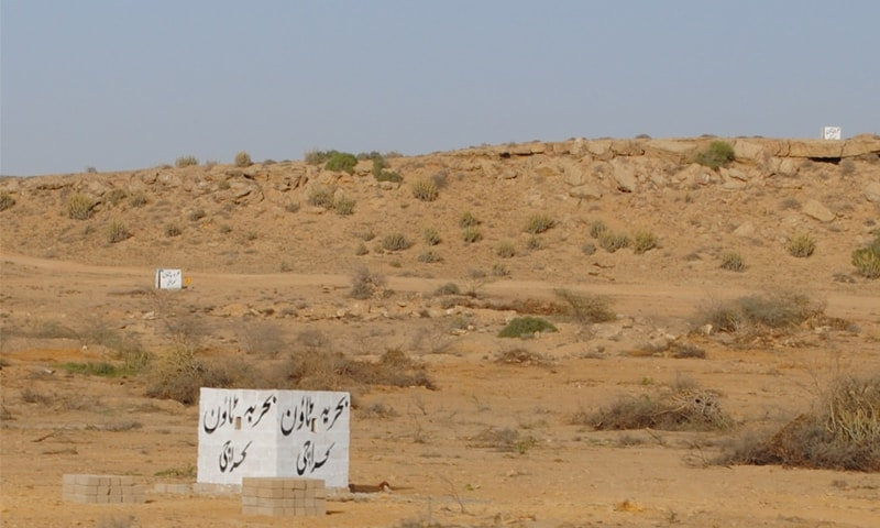 Bahria Town markers like these are found even as far as the Karachi-Jamshoro border. ─ White Star
