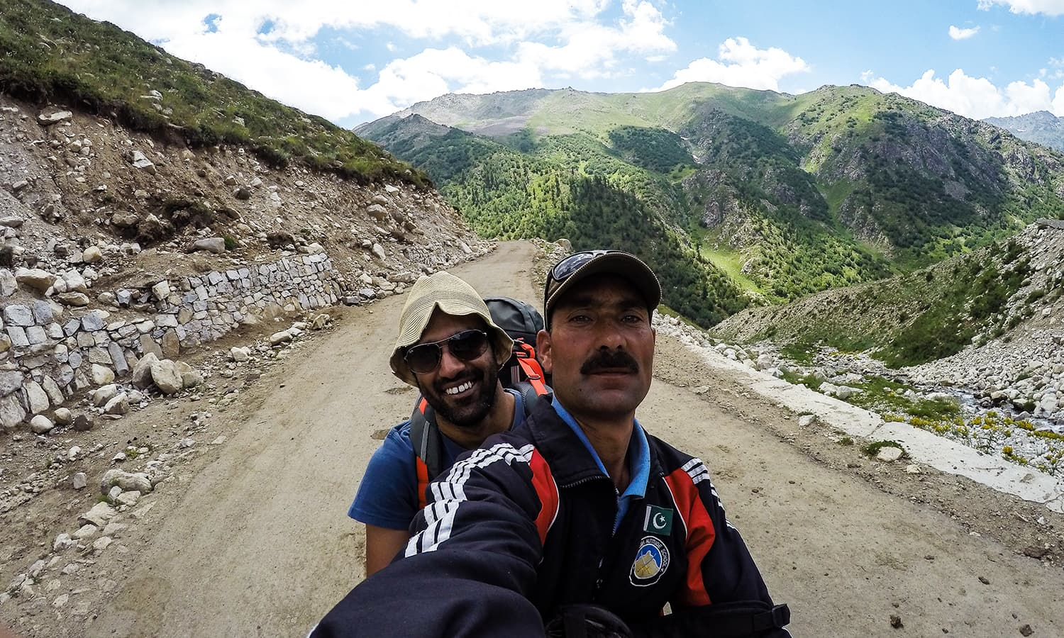With Asghar Ali on his bike.